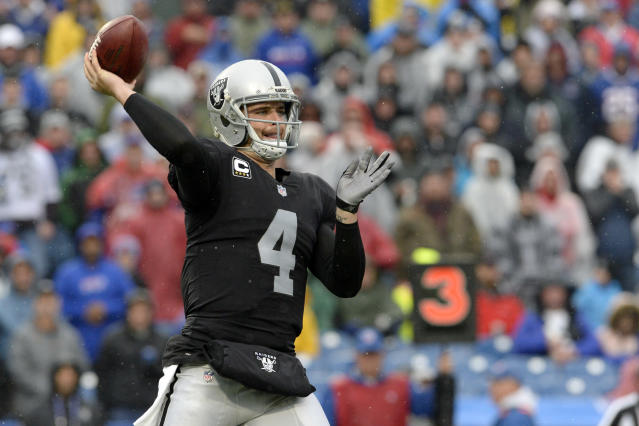 Oakland Raiders quarterback Derek Carr faces an angry Dolphins defense Sunday night in Miami. (AP)