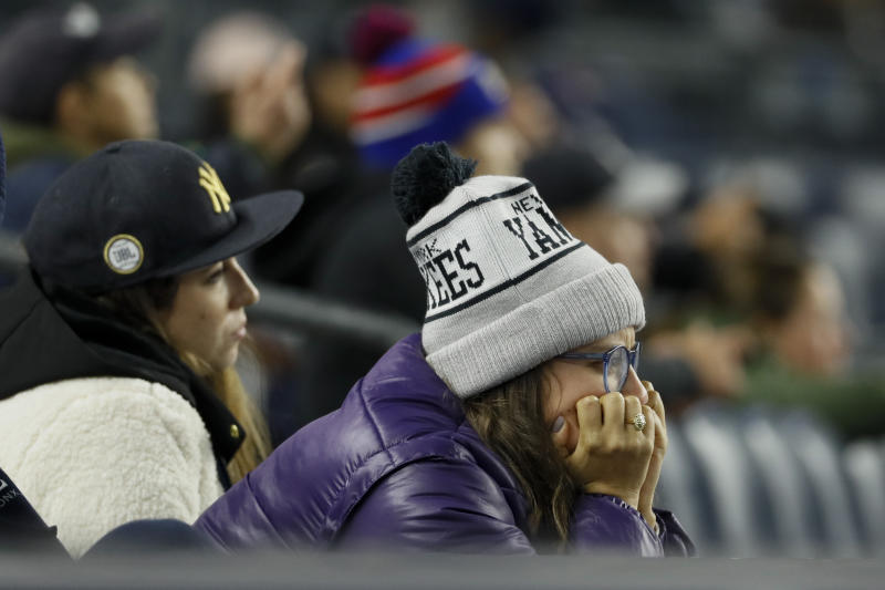 New York Yankees fans watch during the ninth inning in Game 4 of baseball's American League Championship Series 8-3 loss against the Houston Astros Friday, Oct. 18, 2019, in New York. (AP Photo/Matt Slocum)