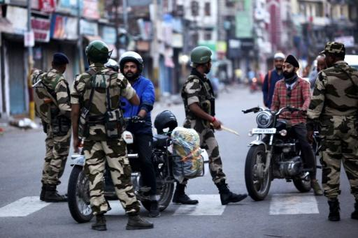 India has imposed a security clampdown on Kashmir and is rushing a bill through parliament to scrap the region's special status