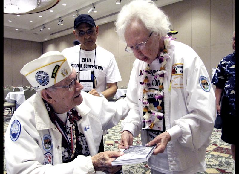 Pearl Harbor Suvivors Association President Art Herriford, left, is seen talking to his wife Shirley at the group's convention in Honolulu on Monday, Dec. 6, 2010. The association, which met in Waikiki a day before the anniversary, decided Monday not to disband and will continue for at least a while longer.