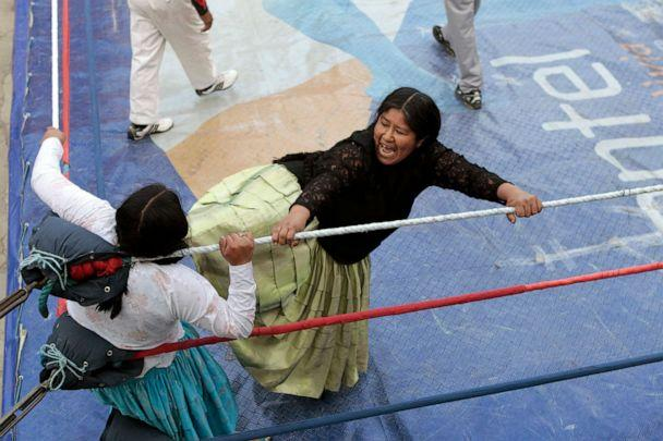 PHOTO: Bolivian Aymara wrestler 'Carmen Rosa' battles with her cholita opponent in a popular sports gym in La Paz, May 23, 2010. (David Mercado/Reuters, FILE)