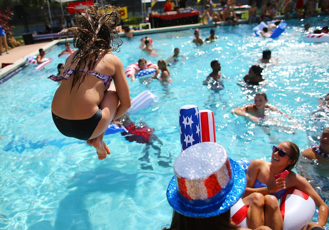 Students play in the campus pool prior to the debate between U.S. President Barack Obama and Republican presidential candidate Mitt Romney at Lynn University on October 22, 2012 in Boca Raton, Florida. The final presidential debate before election day on November 6th focuses on foreign policy.  (Photo by Joe Raedle/Getty Images)