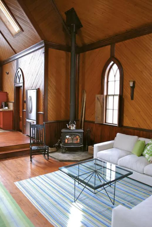 <p>Here's the cozy den with a wood-burning fireplace. </p>