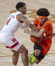 Nebraska guard Shamiel Stevenson (4) reaches in for the ball against Illinois' Andre Curbelo (5) during the first half of an NCAA college basketball game on Friday, Feb. 12, 2021, in Lincoln, Neb. (Francis Gardler/Lincoln Journal Star via AP)