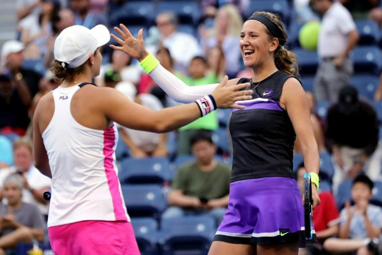 Australia's Ashleigh Barty, left, and Victoria Azarenka of Belarus celebrate after winning a US Open women's doubles semi-final on Thursday