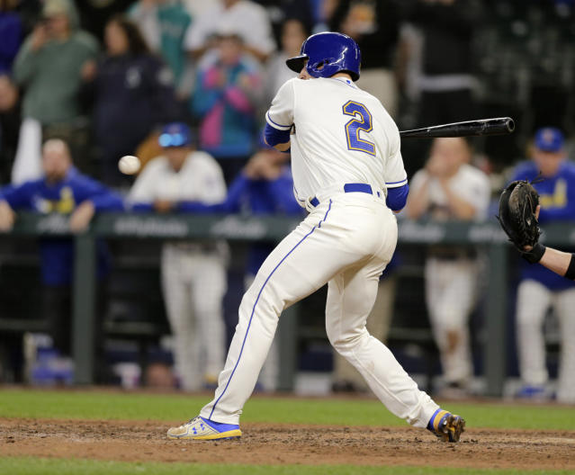 Seattle Mariners' Tom Murphy watches ball four for a bases-loaded walk from Chicago White Sox relief pitcher Jose Ruiz in the bottom of the ninth inning to win a baseball game, Sunday, Sept. 15, 2019, in Seattle. (AP Photo/John Froschauer)