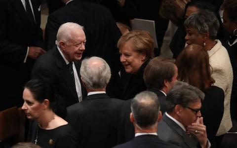 Former President Jimmy Carter, left, and Angela Merkel, Germany's chancellor - Credit: Bloomberg