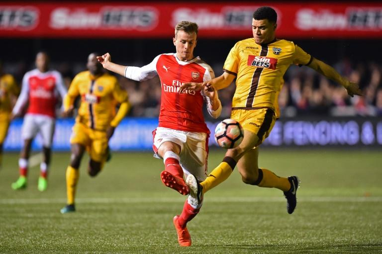 Sutton United striker Maxime Biamou (right) vies with Arsenal's defender Rob Holding during their English FA Cup match at the Borough Sports Ground, Gander Green Lane in south London on February 20, 2017