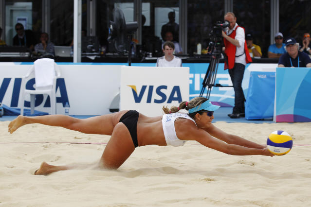 Brazil's Angela Vieira plays a return to U.S.'s April Ross and Jennifer Kessy during the gold medal match in the FIVB Beach Volley International Olympic test event tournament at Horse Guards Parade in London, Sunday, Aug. 14, 2011. Horse Guards Parade will host the London 2012 Olympic beach volley competition next year. (AP Photo/Sang Tan)