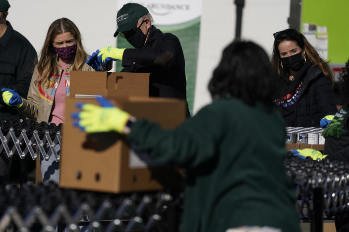 President-elect Joe Biden participates in a National Day of Service event at Philabundance, a hunger relief organization, with his daughter Ashley Biden, right, and his granddaughter Finnegan Biden, left, Monday, Jan. 18, 2021, in Philadelphia. (AP Photo/Evan Vucci)