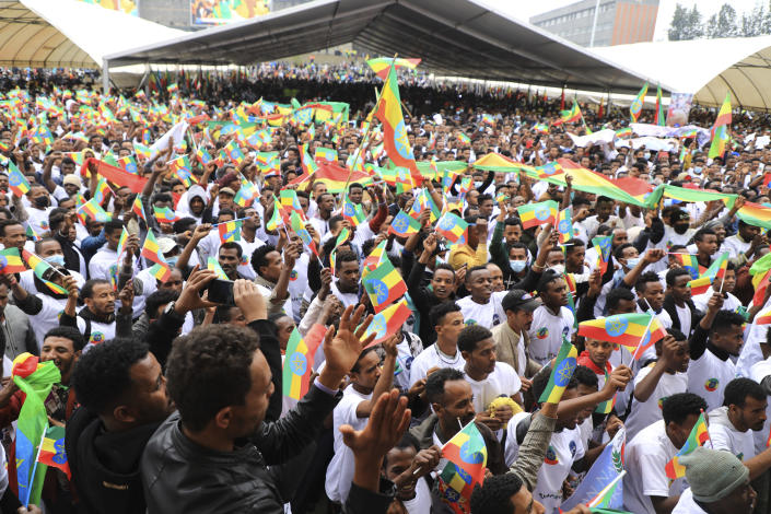 People joining the Defense Forces gather in Meskel Square, Addis Ababa, Ethiopia, Tuesday, July 27 2021. A repatriation program is underway for young people from Ethiopia who have decided to join the Defense Forces. (AP Photo)