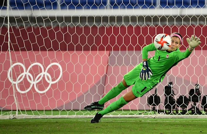 Canada's Steph Labbé lays out to save a penalty kick.