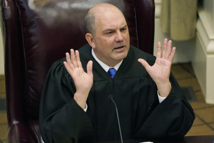 Mississippi Supreme Court Associate Justice Robert Chamberlin, questions attorneys presenting arguments over a lawsuit that challenges the state's initiative process and seeks to overturn a medical marijuana initiative that voters approved in November 2020, Wednesday, April 14, 2021, in Jackson, Miss. (AP Photo/Rogelio V. Solis)