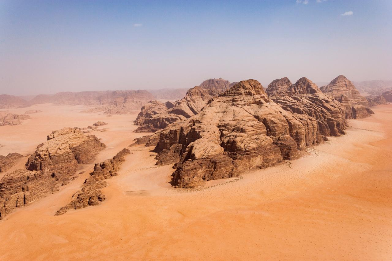 "<p>With its rust-colored landscape and dramatic rock formations, there's little wonder why <a href=""https://www.cntraveler.com/story/traveling-through-jordans-historic-ruins-red-dunes-and-dead-sea?mbid=synd_yahoo_rss"" target=""_blank"">Wadi Rum in Jordan</a> is known as ""The Valley of the Moon."" Wadi Rum's lunar landscape was determined to be the perfect place to set the scene for Planet Jedha in the last of the saga, <em>The Rise of Skywalker.</em> To get a feel of what Planet Jedha, or Wadi Rum, looks like before seeing the movie in theaters, look no further than the <a href=""https://www.youtube.com/watch?v=AXbP_toJWq0"" target=""_blank"">film's teaser</a>—Rey's backflip over a TIE Silencer is set here.</p> <p>""Wadi Rum is breathtakingly beautiful and the perfect location for our film,"" said J.J. Abrams, the film's director, in a statement released by <a href=""http://www.film.jo/NewsView.aspx?NewsId=175"" target=""_blank"">the Royal Film Commission Jordan</a>. Other filmmakers agree—the area <a href=""https://www.cntraveler.com/stories/2015-10-02/the-martian-comes-to-earth-filming-locations-for-the-red-planet?mbid=synd_yahoo_rss"" target=""_blank"">served as Mars</a> in Ridley Scott's <em>The Martian</em>, too.</p> <p><strong>Getting there</strong><br> Fly into Queen Alia International Airport (QAIA) outside of Amman and then head south on the Desert Highway for a direct, four-hour journey. Or, take the more scenic, 5,000-year-old Kings Highway, which adds another two hours for a six-hour drive but allows for pit stops in <a href=""http://na.visitjordan.com/Wheretogo/Madaba.aspx"">Madaba</a>, known as ""The City of Mosaics"" for its Byzantine and Umayyad mosaics, and <a href=""https://www.cntraveler.com/story/hiking-the-jordan-trail-to-petra?mbid=synd_yahoo_rss"" target=""_blank"">Petra, a UNESCO World Heritage Site</a> set in a narrow gorge that's the country's most popular tourist destination. (If you're already in Petra, minibuses also travel to Wadi Rum daily; schedule information can be found at the local minibus stations.)</p> <p><strong>Playing there</strong><br> Stop by the Wadi Rum Visitor Center where you can book 4x4 and camel tours into the desert; or, float overhead in a hot air balloon or microlight aircraft. Or, leave the planning to <em>Condé Nast Traveler</em> travel specialist <a href=""https://www.cntraveler.com/contributors/james-berkeley?mbid=synd_yahoo_rss"" target=""_blank"">James R. Berkeley</a>, who will design a memorable multi-day trip thanks to his insider's perspective.</p> <p><strong>Staying there</strong><br> Camping and bed and breakfasts are the overnight options in Wadi Rum Protected Area, a <a href=""https://www.cntraveler.com/galleries/2016-07-19/unesco-newest-world-heritage-sites?mbid=synd_yahoo_rss"" target=""_blank"">UNESCO World Heritage Site</a>. Check out <a href=""https://fave.co/2rR4MrP"" rel=""nofollow"" target=""_blank"">Arabian Nights</a>, a traditional tent camp owned and operated by local Bedouins.</p>"