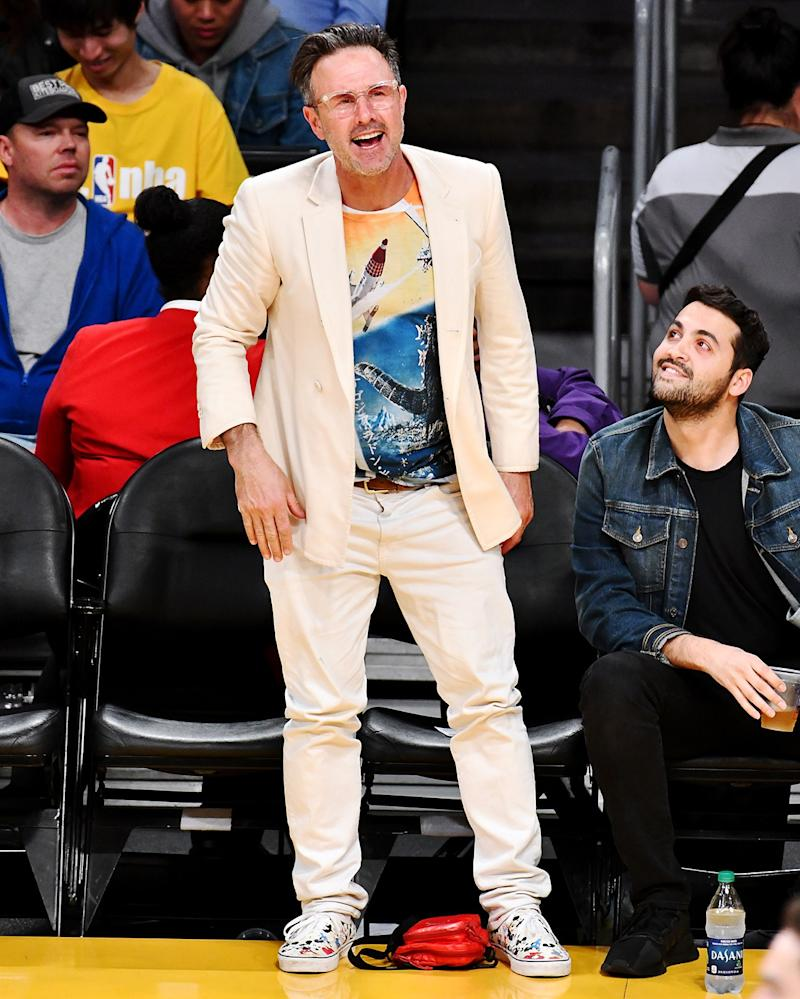 David Arquette practices next-level courtside style.