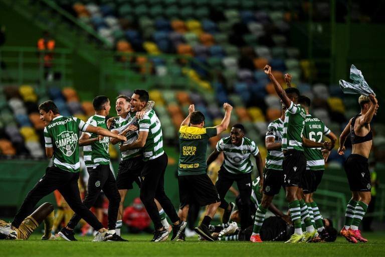 Sporting's players celebrate after ending their long title famine
