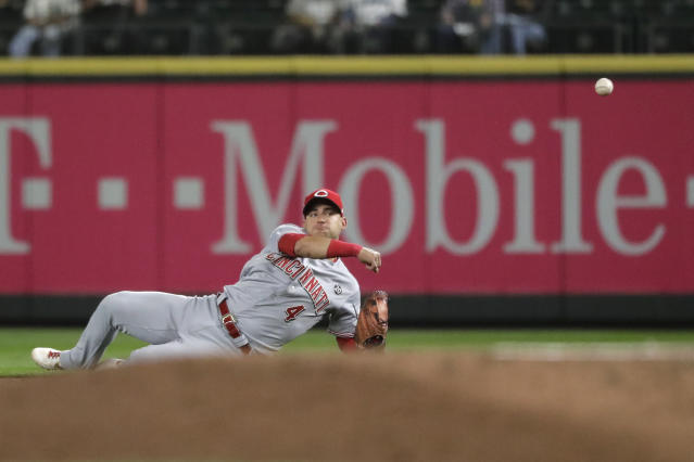 Cincinnati Reds shortstop Jose Iglesias throws to first to get Seattle Mariners' Omar Narvaez out during the fifth inning of a baseball game Wednesday, Sept. 11, 2019, in Seattle. (AP Photo/Ted S. Warren)