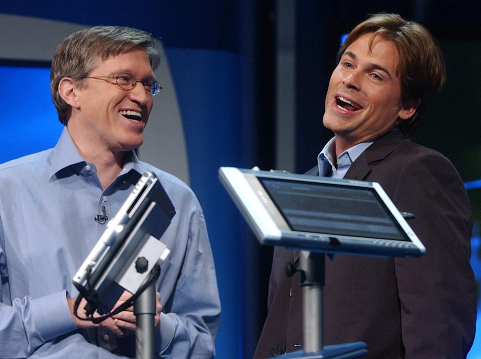 Jeff Raikes, group vice president of the Productivity and Business Systems Group at Microsoft, left, jokes around with Actor Rob Lowe, as he describes his experiences using a Tablet PC at the product launch event in New York City, Thursday, Nov. 7, 2002. Tablet PCs combine the full power of the Windows XP Tablet PC Edition operating system with the capability to use a digital pen in addition to a keyboard or mouse. (AP Photo/Suzanne Plunkett)