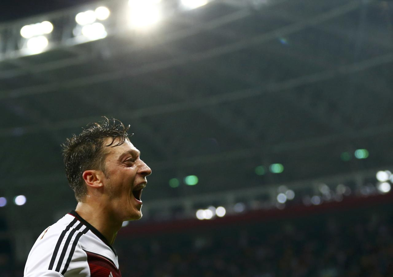 Germany's Mesut Ozil celebrates scoring his team's second goal against Algeria during extra time in their 2014 World Cup round of 16 game at the Beira Rio stadium in Porto Alegre June 30, 2014. REUTERS/Darren Staples (BRAZIL - Tags: SOCCER SPORT WORLD CUP TPX IMAGES OF THE DAY)