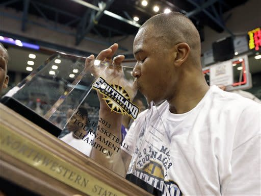 Northwestern State's DeQuan Hicks kisses the championship trophy after winning the Southland Conference championship basketball game against Stephen F. Austin Saturday, March 16, 2013, in Katy, Texas. Northwestern State beat Stephen F. Austin 68-66. (AP Photo/David J. Phillip)