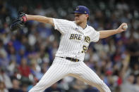 Milwaukee Brewers' Eric Lauer pitches during the first inning of a baseball game against the New York Mets Friday, Sept. 24, 2021, in Milwaukee. (AP Photo/Aaron Gash)