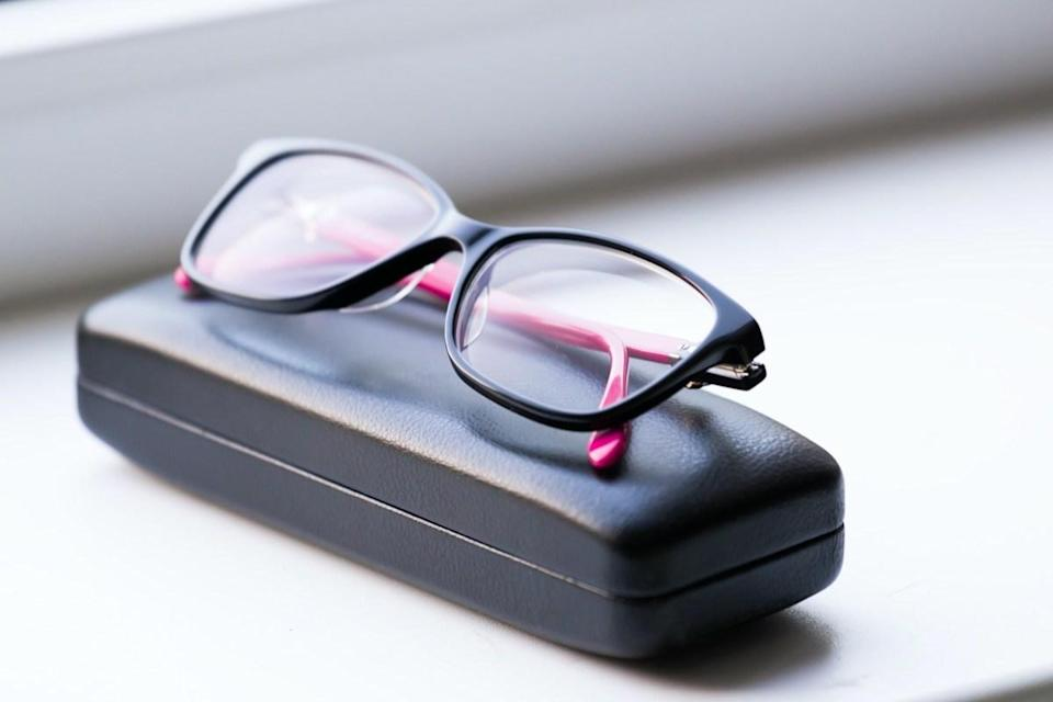 eye glasses and leather case in white background