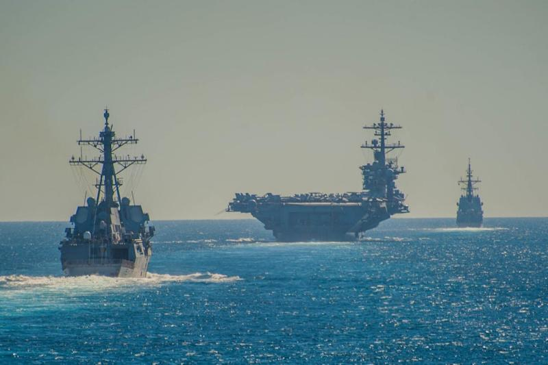 The Arleigh Burke-class guided-missile destroyer USS Bainbridge (DDG 96), left, the Nimitz-class aircraft carrier USS Abraham Lincoln, and the Alvaro de Bazan-class frigate ESPS Méndez Núñez (F 104) transit the Strait of Gibraltar, entering the Mediterranean Sea as it continues operations in the 6th Fleet area of responsibility.