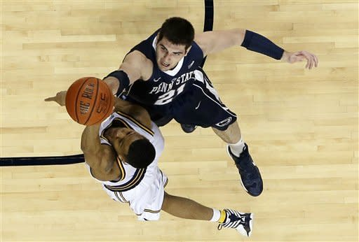 Michigan guard Trey Burke (3) shoots over Penn State forward Sasa Borovnjak (21) during the second half of an NCAA college basketball game at Crisler Center in Ann Arbor, Mich., Sunday, Feb. 17, 2013. (AP Photo/Carlos Osorio)