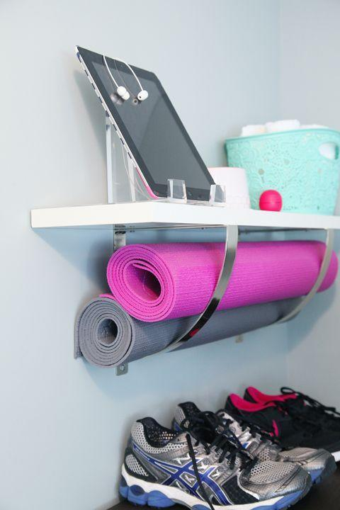 """<p>A yoga mat is one of those things that doesn't take up too much space yet can be awkward to store. The best bet is to hang them on the wall, like this brilliant idea that places the yoga mat in a shelf bracket.</p><p><a href=""""http://www.iheartorganizing.com/2014/01/exercising-my-right-to-organize.html"""" rel=""""nofollow noopener"""" target=""""_blank"""" data-ylk=""""slk:Get the tutorial at I Heart Organizing »"""" class=""""link rapid-noclick-resp""""><em>Get the tutorial at I Heart Organizing »</em></a></p>"""
