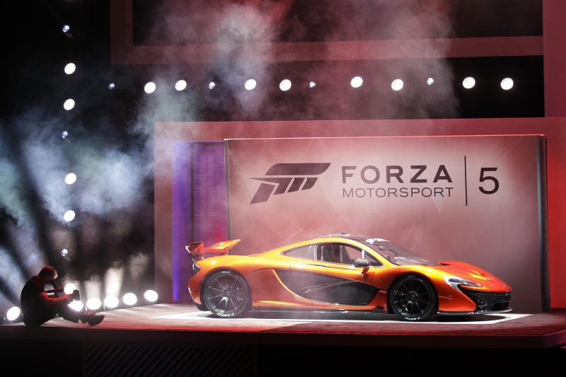A McLaren P1 is showcased during a presentation on the Forza Motorsport 5 video game at the Microsoft Xbox E3 media briefing in Los Angeles, Monday, June 10, 2013. Microsoft focused on how cloud computing will make games for its next-generation Xbox One console more immersive during its Monday presentation at the Electronic Entertainment Expo. Microsoft announced last week that the console must be connected to the Internet every 24 hours to operate, and the system would ideally always be online. (AP Photo/Jae C. Hong)