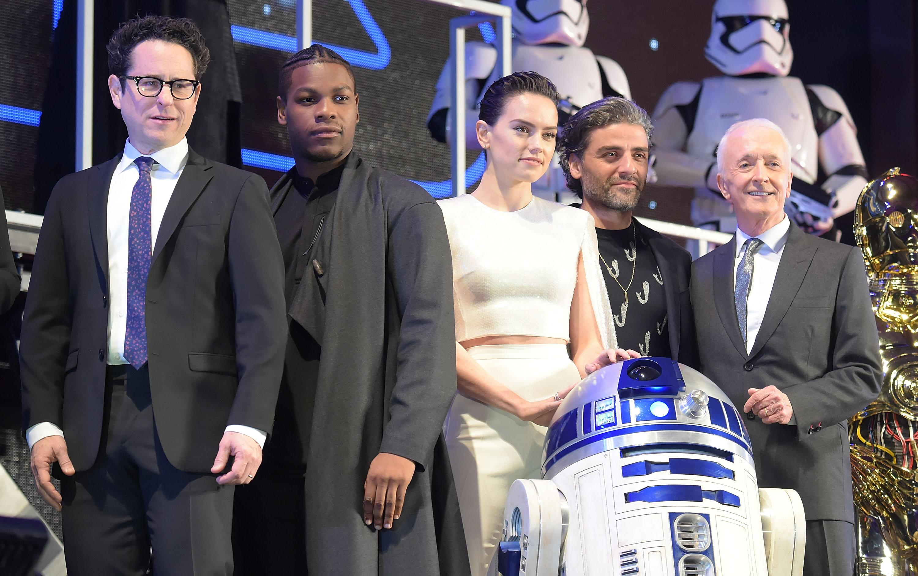 TOKYO, JAPAN - DECEMBER 11: (L-R) Director J.J. Abrams, John Boyega, Daisy Ridley, Oscar Isaac and Anthony Daniels attend the special fan event for 'Star Wars: The Rise of Skywalker' at Roppongi Hills on December 11, 2019 in Tokyo, Japan. (Photo by Jun Sato/WireImage)