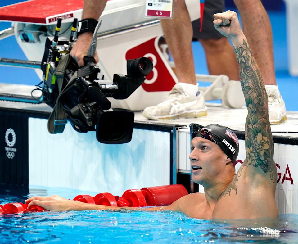 Caeleb Dressel celebrates after winning the men's 100m butterfly final during the Tokyo 2020 Olympic Summer Games at Tokyo Aquatics Centre.