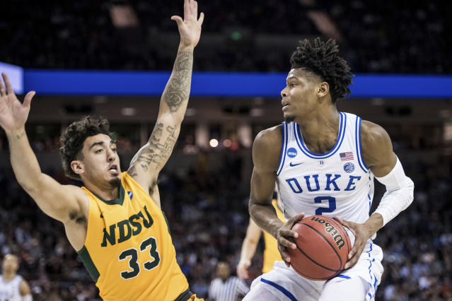 Duke forward Cam Reddish (2) makes a move against North Dakota State guard Jordan Horn (33) during the first half of a first-round game in the NCAA mens college basketball tournament Friday, March 22, 2019, in Columbia, S.C. (AP Photo/Sean Rayford)