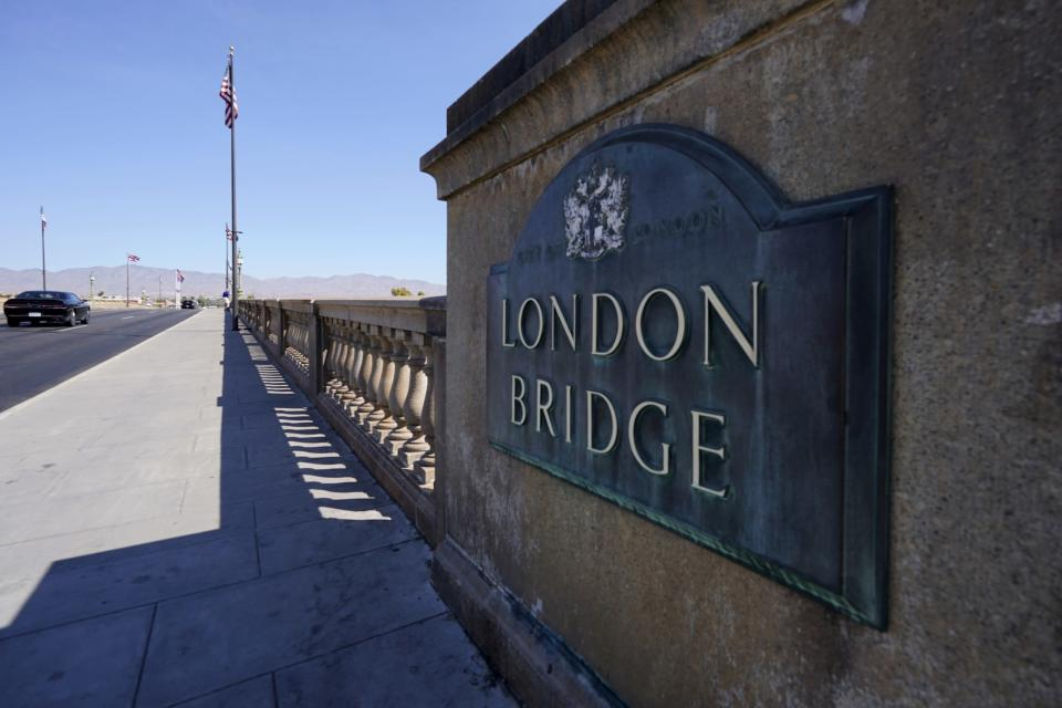 FILE -This Oct. 14, 2020 file photo shows the landmark London Bridge in Lake Havasu City, Ariz. Lake Havasu City is playing up its roots with a month of celebratory events marking the 50th anniversary of the dedication of the London Bridge after its piece-by-piece rebuild in the resort town along the Colorado River. Scheduled October events include a parade, powerboat racing, theater and musical performances, sports competitions and a garden brunch and tea. (AP Photo/Ross D. Franklin,File)