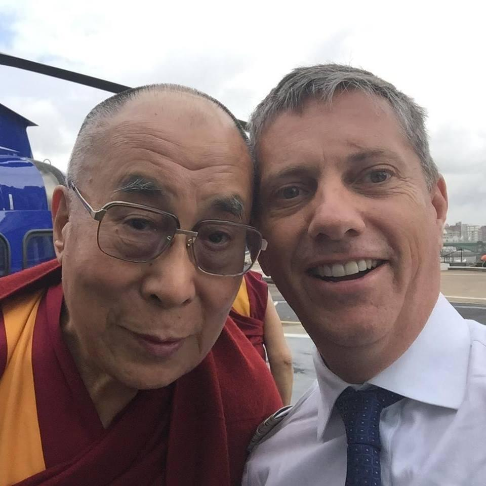 Pilot Eric Swaffer, who died in the crash, pictured with the Dalai Lama. (PA)