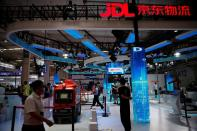 An autonomous delivery robot is displayed at the booth of JD Logistics, the delivery arm of JD.com, during World Robot Conference 2021 in Beijing