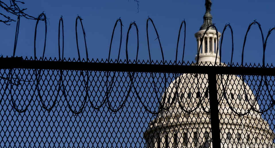 US authorities have stepped up security at the Capitol ahead of the inauguration of President-elect Joe Biden. Source: AP