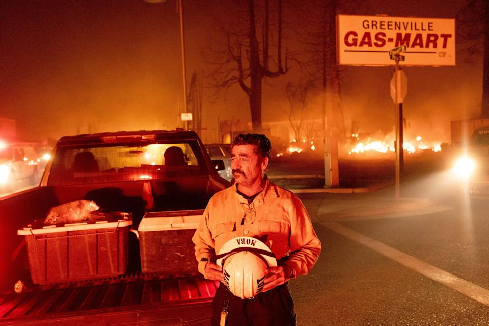 Battalion Chief Sergio Mora watches as the Dixie Fire tears through the Greenville community of Plumas County, Calif., on Wednesday, Aug. 4, 2021.