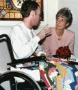"""FILE- In this file photo dated Oct. 26, 1991, Princess Diana talks with AIDS patient Wayne Taylor at the Casey House AIDS hospice in Toronto, Canada. For someone who began her life in the spotlight as """"Shy Di,"""" Princess Diana became an unlikely, revolutionary during her years in the House of Windsor. She helped modernize the monarchy by making it more personal, changing the way the royal family related to people. By interacting more intimately with the public -- kneeling to the level of children, sitting on edge of a patient's hospital bed, writing personal notes to her fans -- she set an example that has been followed by other royals as the monarchy worked to become more human and remain relevant in the 21st century. AP Photo/Hans Deryk, File)"""