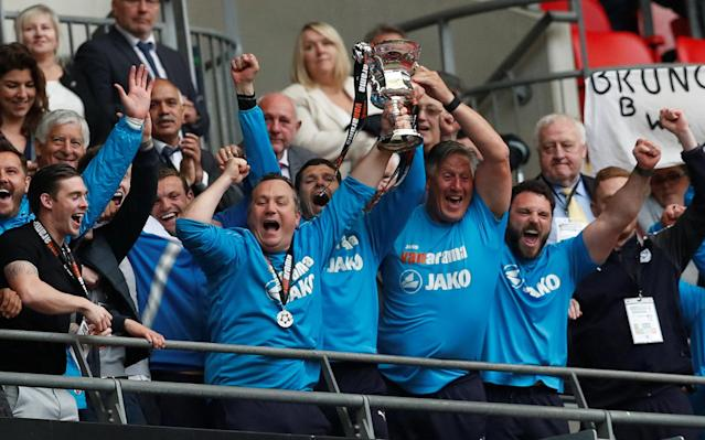 Soccer Football - National League Promotion Final - Tranmere Rovers v Boreham Wood - Wembley Stadium, London, Britain - May 12, 2018 Tranmere Rovers manager Micky Mellon and staff celebrate with the trophy after the match Action Images/Matthew Childs