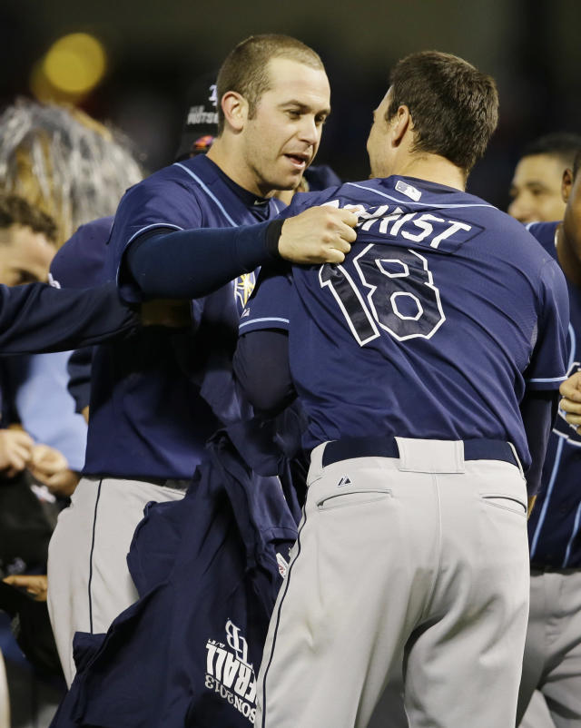Tampa Bay Rays' Evan Longoria, left, and Ben Zobrist (18) celebrate after defeating the Texas Rangers 5-2 in their American League wild-card tiebreaker baseball game Monday, Sept. 30, 2013, in Arlington, Texas.(AP Photo/Tony Gutierrez)