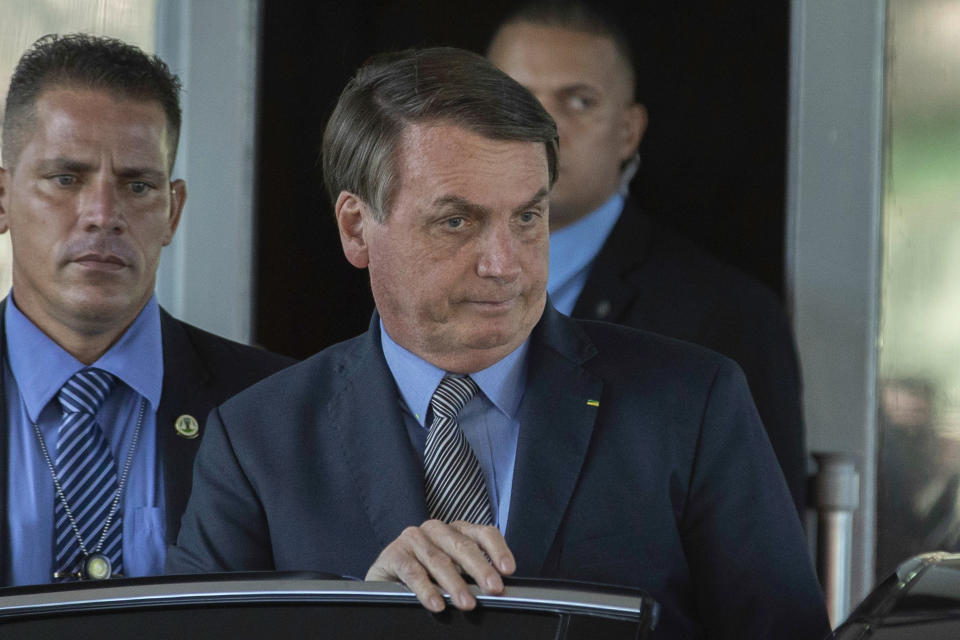 President Jair Bolsonaro leaves the headquarters of the Ministry of Economy in Brasília, Brazil on Mar. 16, 2020. Even with recommendations to remain in isolation, the president had meetings with Minister Paulo Guedes. (Photo: Bruno Rocha/Fotoarena/Sipa USA)(Sipa via AP Images)