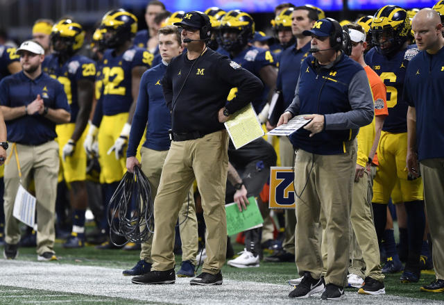 Michigan head coach Jim Harbaugh looks on during the second half of the Peach Bowl against Florida on Dec. 29, 2018, in Atlanta. Florida won 41-15. (AP Photo/Mike Stewart)