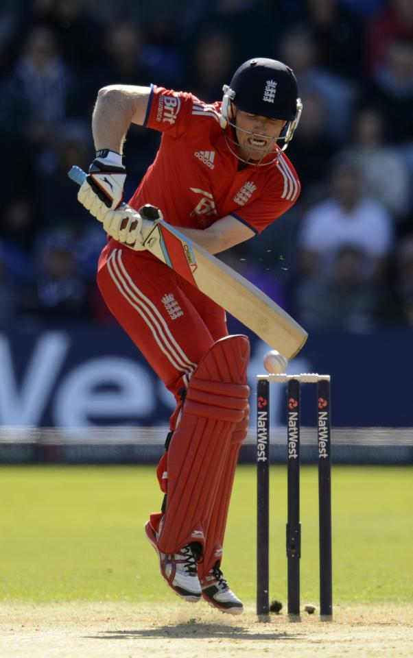 England's captain Eoin Morgan plays a shot during the fourth one-day international against Australia at Sophia Gardens in Cardiff, Wales September 14, 2013. REUTERS/Philip Brown (BRITAIN - Tags: SPORT CRICKET)