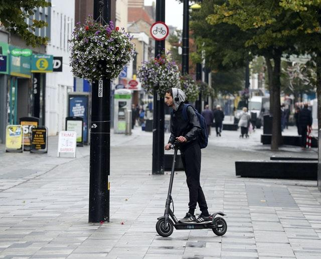 E-scooters should be legalised on UK roads, according to the Commons transport committee (Steve Parsons/PA)