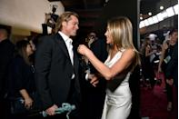 """<p>In 2020, Aniston won for Outstanding Performance by a Female Actor in a Drama Series for her work in <em>The Morning Show</em> at the SAG Awards—but that's not what made headlines everywhere the next morning. A friendly <a href=""""https://www.elle.com/culture/celebrities/a30631595/jennifer-aniston-brad-pitt-photographer-sag-awards/"""" rel=""""nofollow noopener"""" target=""""_blank"""" data-ylk=""""slk:moment"""" class=""""link rapid-noclick-resp"""">moment</a> between Aniston and her ex, Brad Pitt, backstage was photographed and sent the world into a whirlwind of Brad and Jen speculation. </p>"""