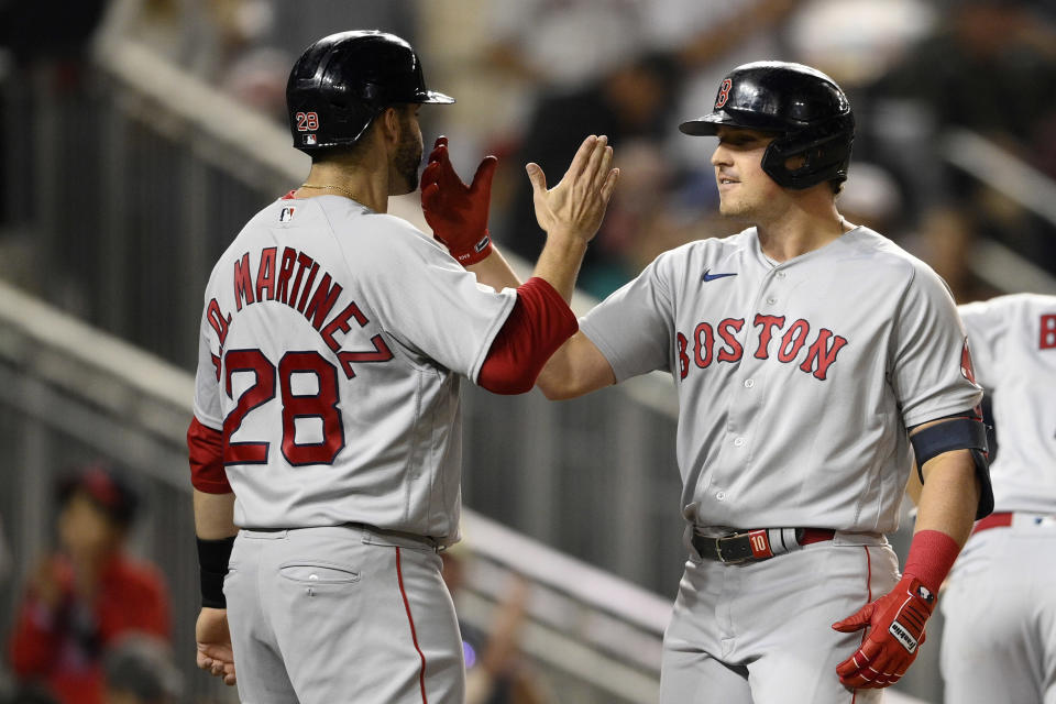 Boston Red Sox's Hunter Renfroe, right, celebrates his three-run home run with J.D. Martinez (28) during the sixth inning of a baseball game against the Washington Nationals, Friday, Oct. 1, 2021, in Washington. (AP Photo/Nick Wass)