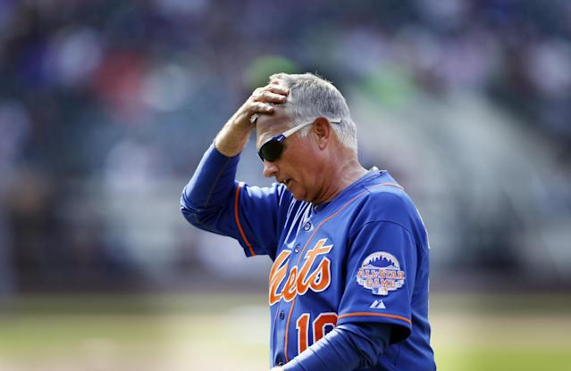 New York Mets manger Terry Collins walks off the field after getting ejected in the 10th inning of the baseball game against the Atlanta Braves at Citi Field Wednesday, Aug. 21, 2013 in New York. The Braves beat the Mets 4-1. (AP Photo/Seth Wenig)