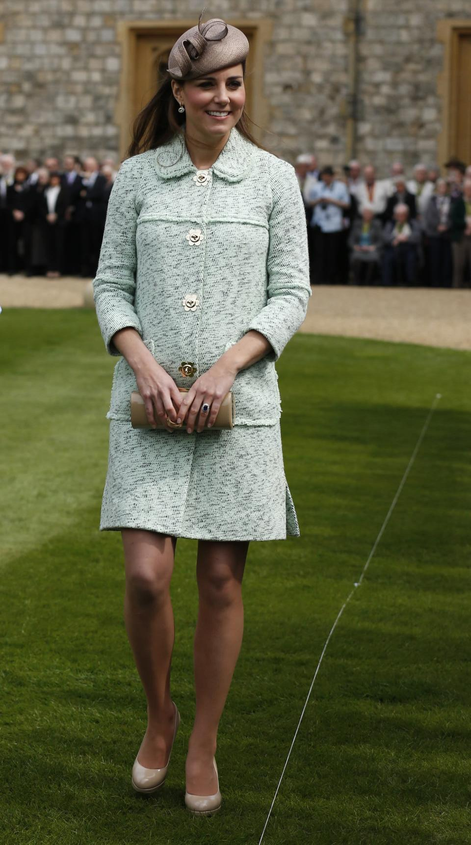 <p>Kate Middleton dressed her LK Bennett clutch with a mint Mulberry coat for the National Review of Queen's Scouts on 21 April, 2013. <em>[Photo: Getty]</em> </p>