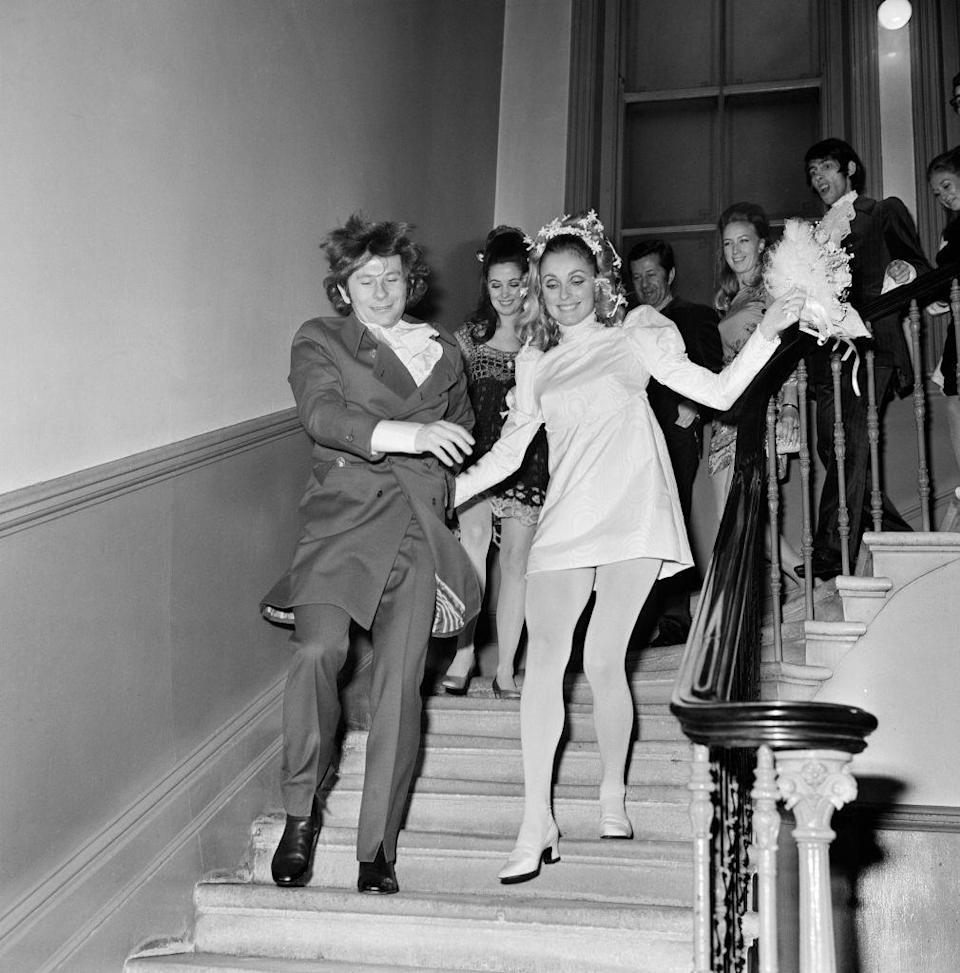 """<p>After marrying at the Chelsea Registry Office, <a href=""""https://www.townandcountrymag.com/society/tradition/a28493697/who-was-sharon-tate-life-death-facts/"""" rel=""""nofollow noopener"""" target=""""_blank"""" data-ylk=""""slk:Sharon Tate"""" class=""""link rapid-noclick-resp"""">Sharon Tate</a> and Roman Polanski race down the stairs to their reception at the Playboy Club in London. </p>"""